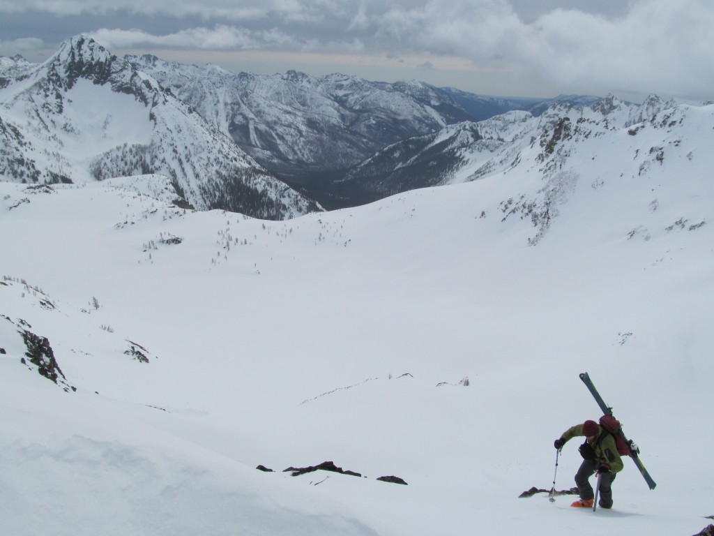 Brennan making his way onto Maudes southern ridge with Ice lakes below
