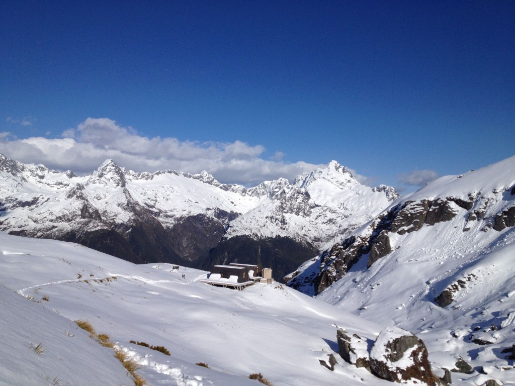 Routeburn Shelter with the mountains of Fiordland in the distance